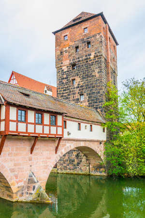 Historical old town with view of Weinstadel, bridge and Henkerturm tower in Nurnberg, Germany.