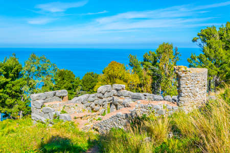 Ruins of a castle situated on La Rocca mountain in Cefalu, Sicily, Italy