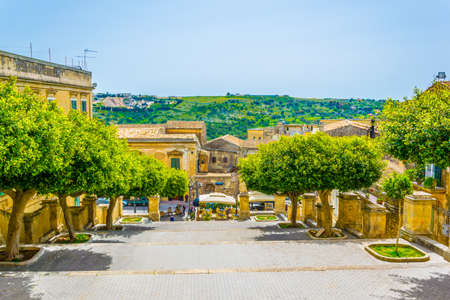 View of a small square in front of the Chiesa di san Giovanni Evangelista in Modica, Sicily, Italy