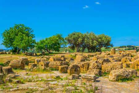 View of ruins of the temple of Castore and Polluce in the Valley of temples near Agrigento in Sicily, Italy