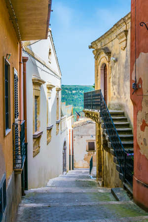View of a narrow street in Ragusa, Sicily, Italy  Stock Photo