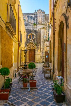 View of a narrow street in Syracuse, Sicily, Italy  Stock Photo