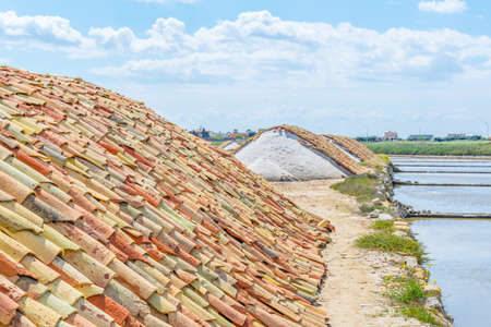 Roof tiles covering piles with salt at the Saline di Trapani, Italy