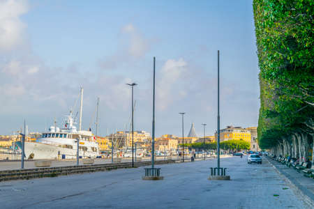 View of the seaside promenade surrounding the old town of Syracuse in Sicily, Italy