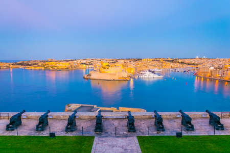 Night view of the Saluting Battery facing Birgu town with Fort st. Angelo and Senglea in Valletta, Malta