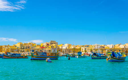 Colorful fishing boats moor in Marsaxlokk, Malta