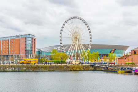 LIVERPOOL, UNITED KINGDOM, APRIL 6, 2017: ECHO convention center and an adjacent ferris wheel in Liverpool, England