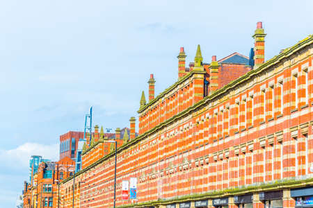 MANCHESTER, UNITED KINGDOM, APRIL 11, 2017: View of the classical brick houses on Deansgate street in Manchester, England