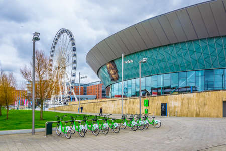 LIVERPOOL, UNITED KINGDOM, APRIL 6, 2017: the ECHO convention center and an adjacent ferris wheel in Liverpool, England