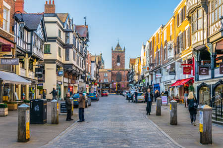 CHESTER, UNITED KINGDOM, APRIL 7, 2017: Traditional tudor houses alongside the Bridge street in the central Chester, England 에디토리얼