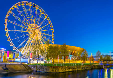 LIVERPOOL, UNITED KINGDOM, APRIL 5, 2017: Night view of the ECHO convention center and an adjacent ferris wheel in Liverpool, England