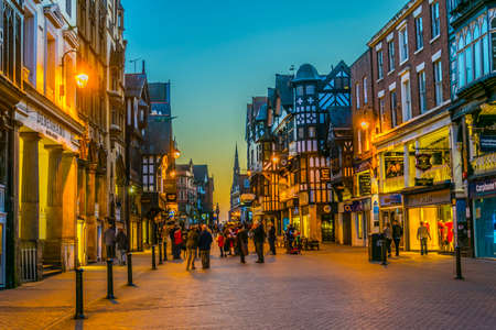 CHESTER, UNITED KINGDOM, APRIL 7, 2017: Sunset view of traditional tudor houses alongside the Northgate street in the central Chester, England