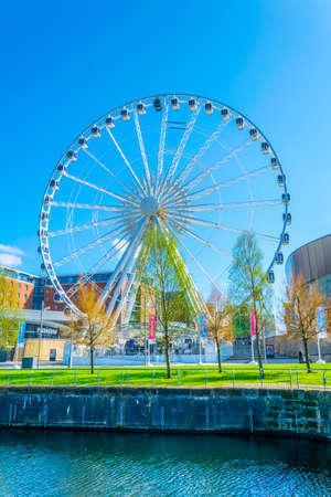 LIVERPOOL, UNITED KINGDOM, APRIL 7, 2017: ECHO convention center and an adjacent ferris wheel in Liverpool, England
