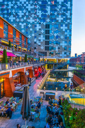 BIRMINGHAM, UNITED KINGDOM, APRIL 8, 2017: Sunset view of a restaurant alongside a water channel in the central Birmingham, England