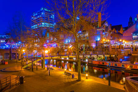 BIRMINGHAM, UNITED KINGDOM, APRIL 8, 2017: Night view of a restaurant alongside a water channel in the central Birmingham, England Editorial