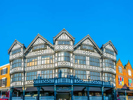 CHESTER, UNITED KINGDOM, APRIL 7, 2017: Traditional tudor houses alongside the Bridge street in the central Chester, England Editorial