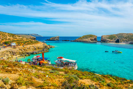 COMINO, MALTA, MAY 1, 2017: Tourist boats are anchoring near comino island, Malta