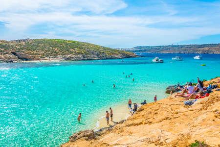 COMINO, MALTA, MAY 1, 2017: Tourists are enjoying turquoise water of the blue lagoon on the comino island, Malta