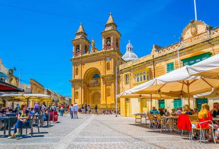 MARSAXLOKK, MALTA, APRIL 30, 2017: View of the Parish Church of Marsaxlokk, Malta Redakční