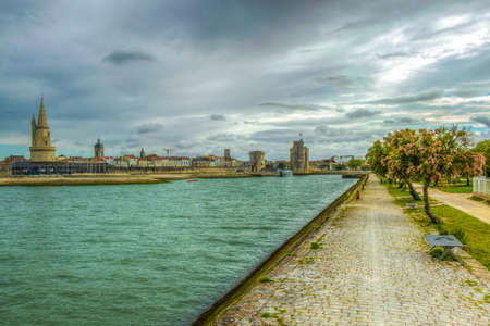 Port of La rochelle guarded by tour de la lanterne, tour de la chaine and tour Saint Nicholas, France