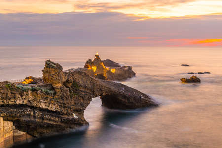 Sunset view of Rocher de la Vierge in Biarritz, France