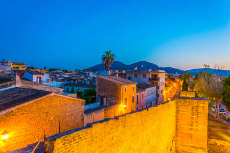 Sunset view of fortification of Alcudia town at Mallorca, Spain