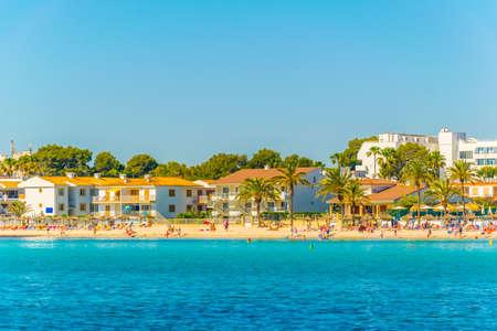 Holiday resorts stretched alongside Alcudia beach on Mallorca, Spain Фото со стока