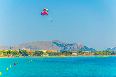 Holiday resorts stretched alongside Alcudia beach on Mallorca, Spain Stock Photo