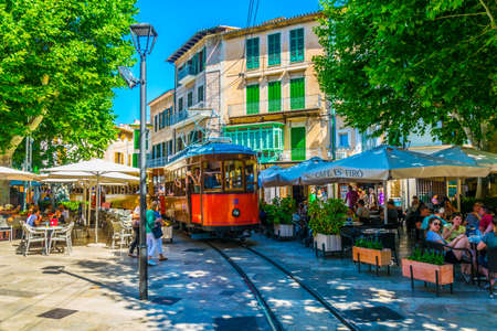 SOLLER, SPAIN, MAY 26, 2017:  Traditional red tram is passing through the center of Soller at Mallorca, Spain