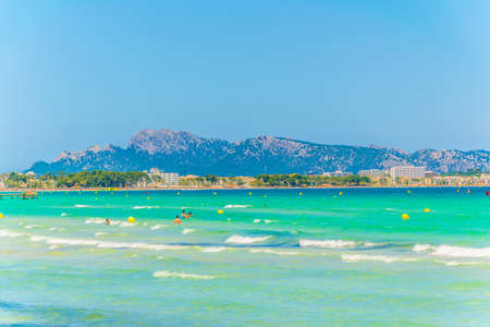 CAN PICAFORT, SPAIN, MAY 23, 2017: Alcudia beach between Port dAlcudia and Can Picafort, Spain