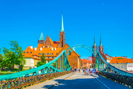 WROCLAW, POLAND, MAY 28, 2017: Church of the Holy Cross and St Bartholomew and cathedral of saint john the baptist in Wroclaw, Poland