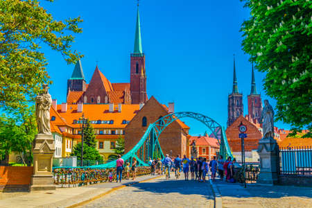 WROCLAW, POLAND, MAY 28, 2017:Riverside of Odra with church of the Holy Cross and St Bartholomew and cathedral of Saint John the Baptist in Wroclaw, Poland