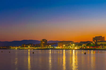 Night view of hotels stretched alongside coastline of Saint Raphael