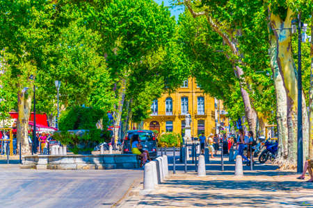 AIX-EN-PROVENCE, FRANCE, JUNE 18, 2017: People are strolling on cours Mirabeau in the center of Aix-en-Provence, France