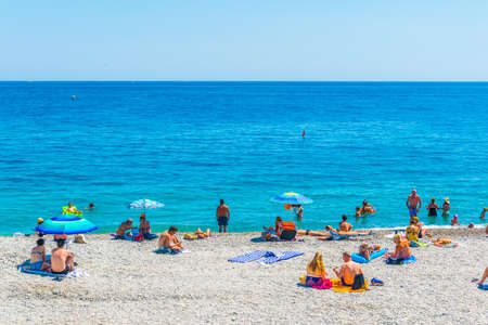 NICE, FRANCE, JUNE 11, 2017: People are enjoying summer on a beach in Nice, France