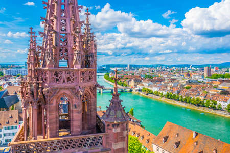 Riverside of Rhine in Basel dominated by majestic building of Munster church, Switzerland