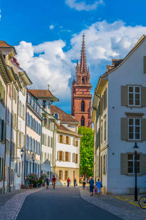 People are coming from the münster church in the old town of Basel, Switzerland