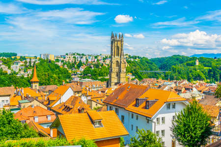 Cityscape of Fribourg dominated by tower of the cathedral of Saint Nicholas, Switzerland