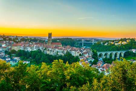 Sunset view over skyline of Fribourg, Switzerland