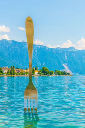 Statue of a giant fork stitched into the Geneva lake in Switzerland
