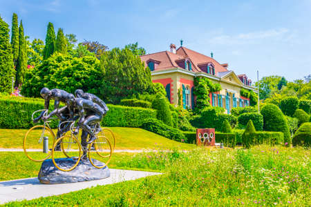 Statue of cyclists in front of the international olympic museum in Lausanne, Switzerland