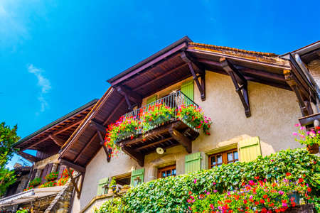 Traditional houses in french medieval town Yvoire situated next to the Geneva lake 写真素材