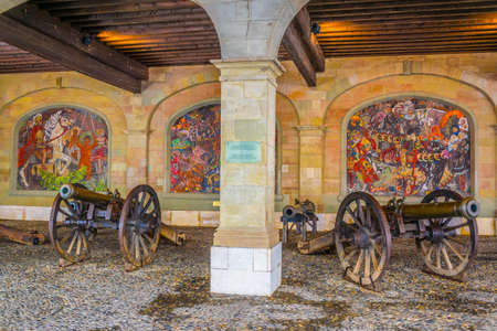 Cannons hiden in an arcade in the swiss city geneva Editorial