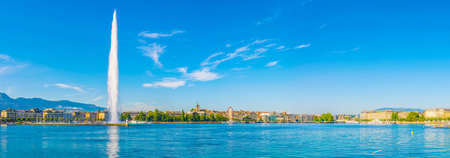 GENEVA, SWITZERLAND: Cityscape of Geneva viewed behind Geneva lake/Lac Leman in Switzerland Stock Photo