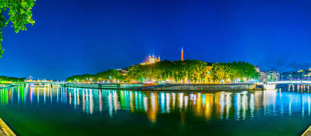 Night view of illuminated basilique de Notre-dame de Fourivere and Saint Georges church in Lyon, France