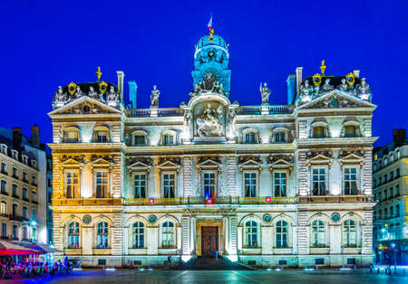 Night view of illuminated town hall in Lyon, France