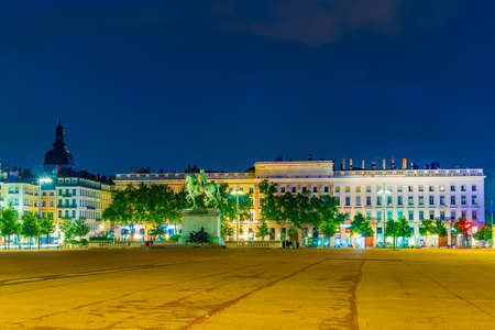 Night view of statue of Louis XIV on Place Bellecour in Lyon, France