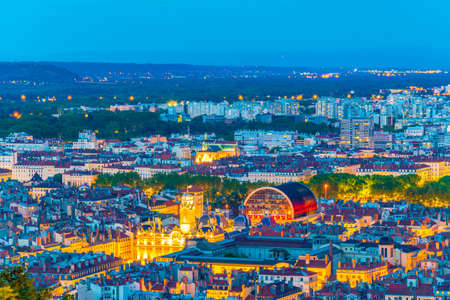 Night aerial view of Lyon dominated by the National opera and town hall, France 免版税图像