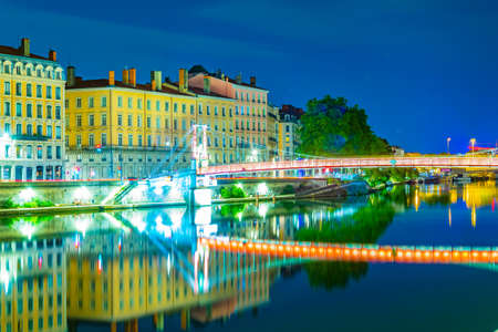 Night view of illuminated riverside of Saone river in Lyon, France