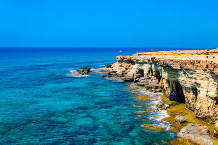Sea caves at cap greco in the south-eastern cyprus